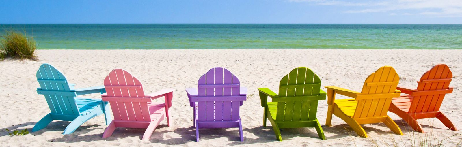Different colored beach chairs on a beach