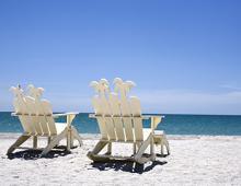 White beach chairs on Captiva Beach